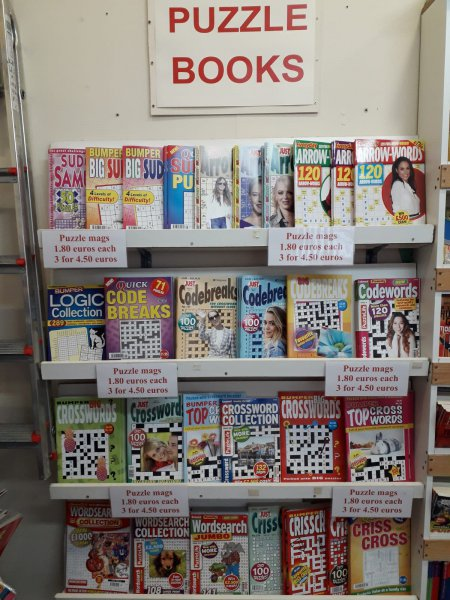 Large selection of puzzle books in English.